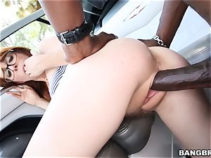 Penny Pax handles herself to a black rod