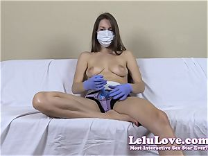 sans bra lady with medical mask and strap on dildo