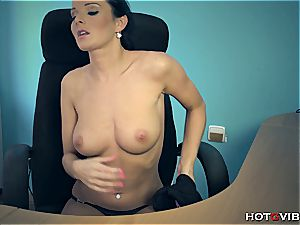 hottie at the office jacks her rosy vagina to an orgasm