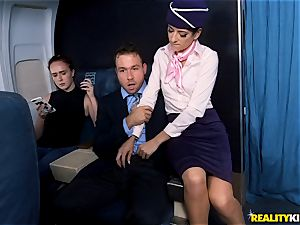 Air hostess Lexy Rose takes a shaft testicles deep on the plane