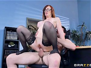 Dani Jensen playing with wood in the office