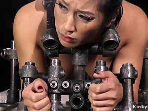big-titted chinese gets bastinade in metal instrument