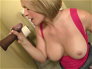 Krissy Lynn gives a blow-job to a ginormous black pink cigar