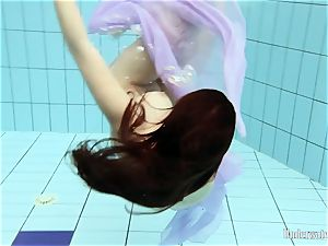 ebony haired Aneta in the pool