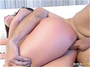 black-haired Britney Amber gets an unexpected pipe filling