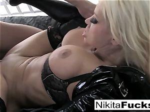 busty Nikita ravages a huge lollipop