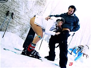 Playful skier Nikky desire takes her trainer's chisel in the snow