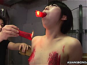 japanese tart loves to be bdsm treated to a paraffin wax show