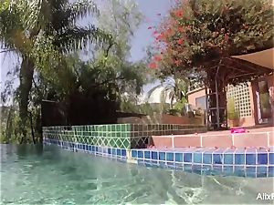 big-chested blondes Alix and Cherie go skinny dipping