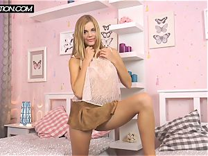 platinum-blonde Chernova capturing her assets