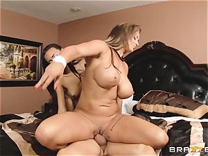 Eva Notty shows her stepdaughter Janice Griffith how to sate a lollipop